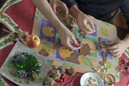 Gingerbread dough with mom and son hands photo