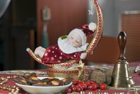 peal: Christmas Doll with bell. Set table.