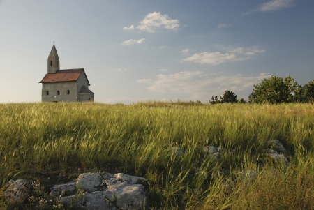evening church: Romanesque church Saint Michael on the rock. Drazovce, Slovakia.