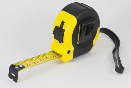 Roll-up tape measure on a white background Stock Photo