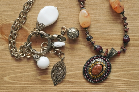 Necklaces on a wooden background photo
