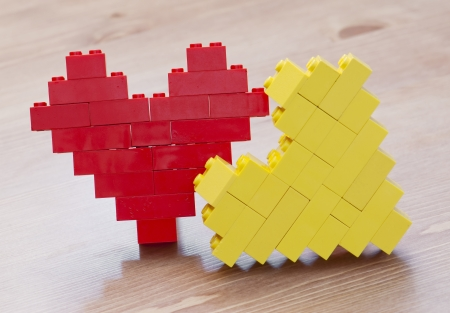 plastic bricks: Hearts made of plastic bricks Stock Photo
