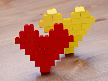 Red building blocks shaped as a heart photo