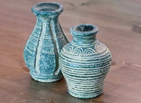 Terracotta vases on a wooden table.