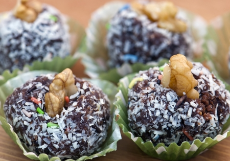 Rum balls in coconut and walnut Stock Photo - 16992265