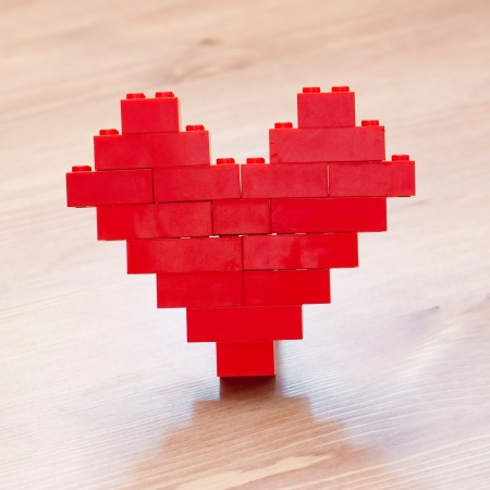 Red valentine heart giving with love Stock Photo - 17019454