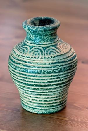Turquoise handmade vase of terracotta photo
