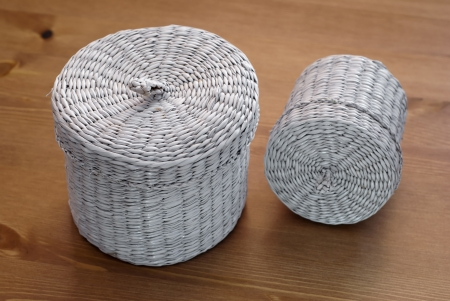 Two white seagrass basket on a wooden table. photo