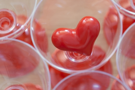 Small red heart stored in a glass. Stock Photo - 17235594