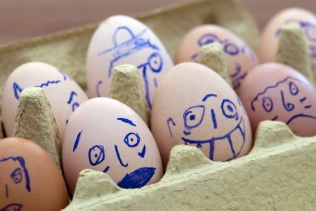Image of various face painted eggs. photo