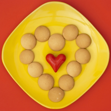 Heart of biscuits with small red heart. Stock Photo