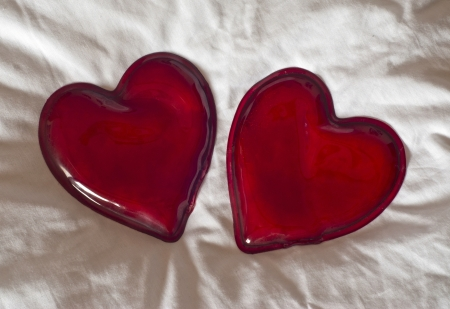 Two red hearts. Symbol of lovers. Stock Photo