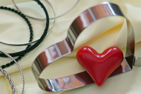 Two shapes of heart with various bracelets. Stock Photo - 17339891
