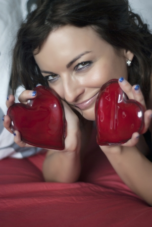 Smiling woman with two red hearts. Stock Photo - 17336435