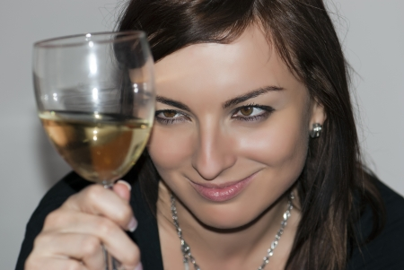 Beautiful woman with glass of white wine. photo