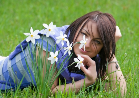 Young beautiful woman smelling daffodils. photo