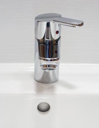 Detail of a chrome bathroom sink. photo