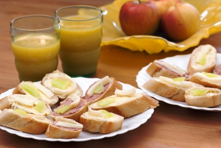 Breakfast  Canapes with juice and apples  photo