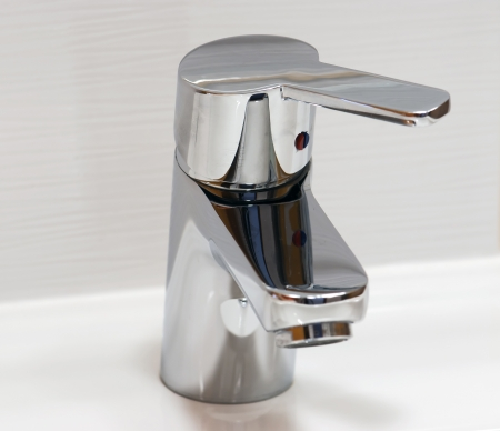 Close up image of water faucet  photo