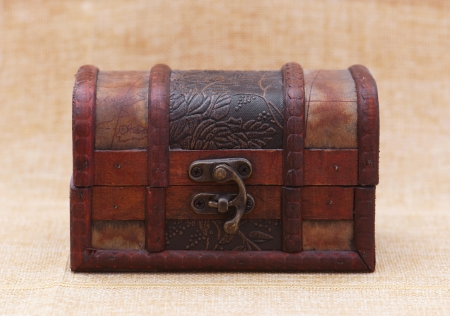 Locked jewellery box on a brown background  photo