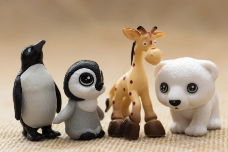Plastic toy figurines  Penguins, giraffe and white teddy bear