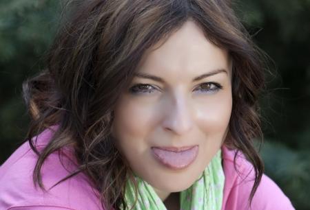 Pretty woman puts out tongue  photo