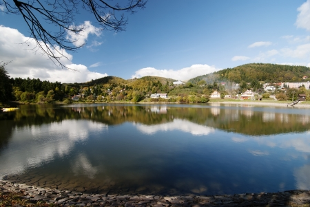 Mirror image of rural countryside with lake by autumn. photo