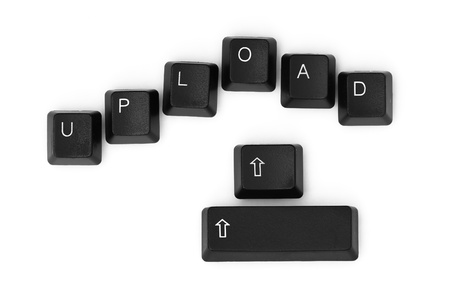 UPLOAD word written on a keyboard. Isolated on a white background. Stock Photo