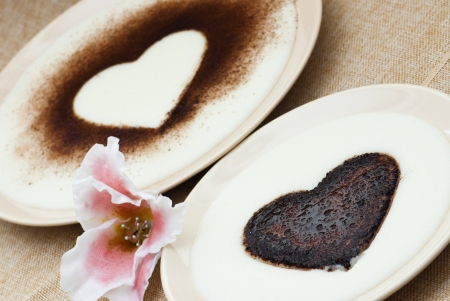 Two hearts in semolina pudding with flower of sugar  photo