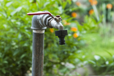 Detail of old garden faucet. photo