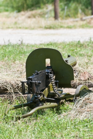 battleground: Green german machine gun of World War II. Ready to fire.