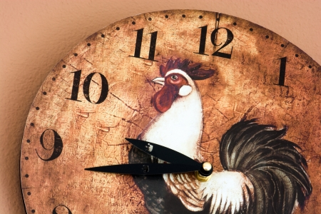 Retro wall clock with a rooster theme. photo