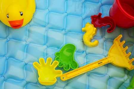 Bright and colorful children toys at poolside. photo