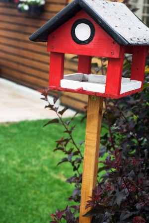 countrylife: Red bird house waiting for new occupants.
