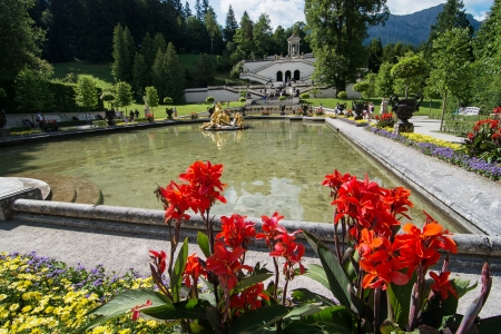 ettal: OBERAMMERGAU, GERMANY - AUGUST 17: Linderhof Palace and garden on August 17, 2013 in Oberammergau, Germany. Linderhof Palace is the smallest of the three palaces built by King Ludwig II of Bavaria.