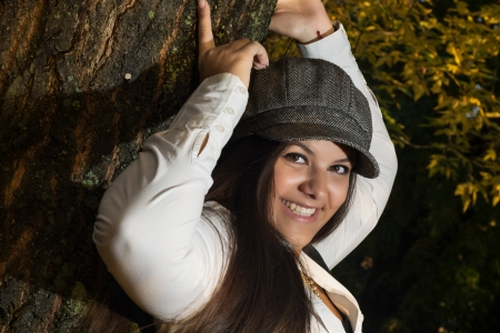 caucasian girl: Happy caucasian girl posing near the tree. Stock Photo