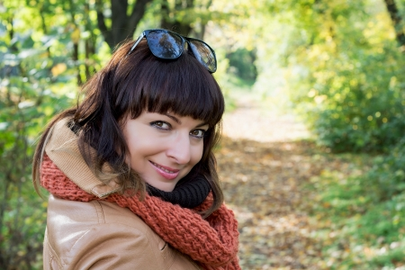 Beautiful caucasian woman posing in autumn park. photo