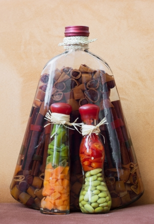 Pickle vegetable and pasta in oil in the glass bottles. Retro style. photo