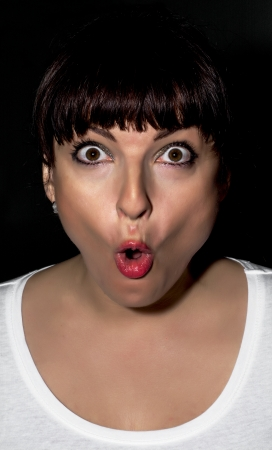 surprised face: Young caucasian woman making surprised face.
