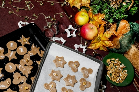 Baking trays with gingerbread christmas cookies. Christmas table. photo