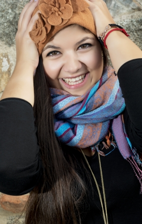 caucasian girl: Young caucasian girl holding her head and smiling. Stock Photo