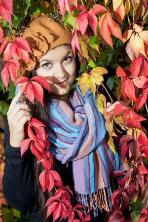 caucasian girl: Beautiful caucasian girl posing with colorful autumn foliage.