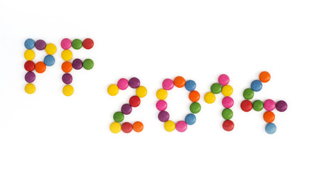pour feliciter: The title PF 2014 written of the colored smarties. New Year theme.