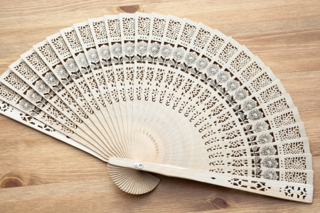 Traditional fan on a wooden photo