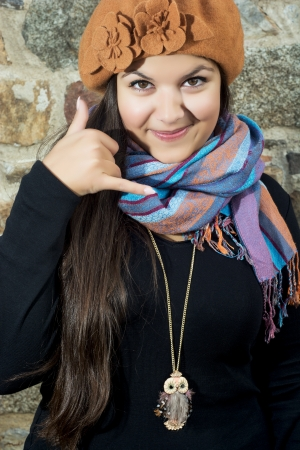 caucasian girl: Young caucasian girl showing calling gesture