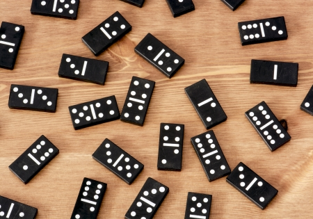 gambling parlour: Black dominoes on the table.