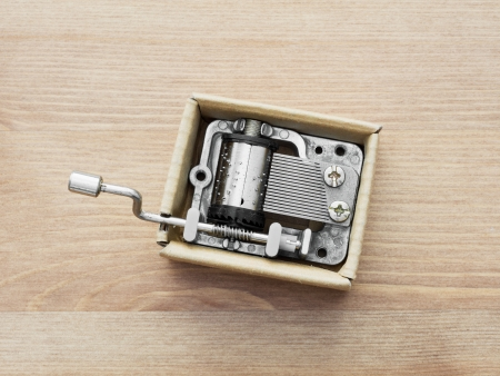 Old little music box on a wooden.