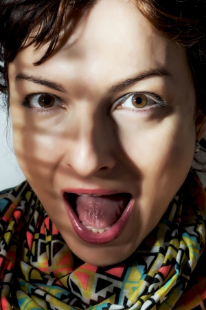 surprised face: Caucasian woman making surprised face. Mouth wide open.