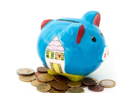 money box: Porcelain piggy bank money box with coins.
