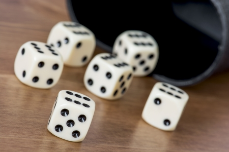 Casino dices with cup on the table. photo